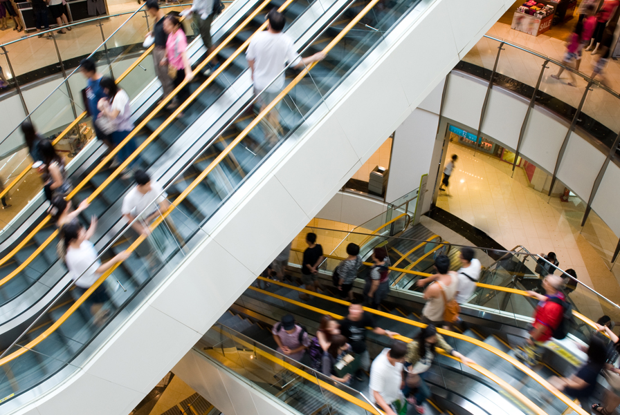 Escalator with people going up and down